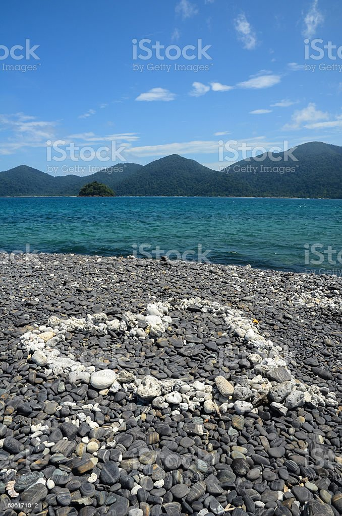 Heart on the stone beach stock photo