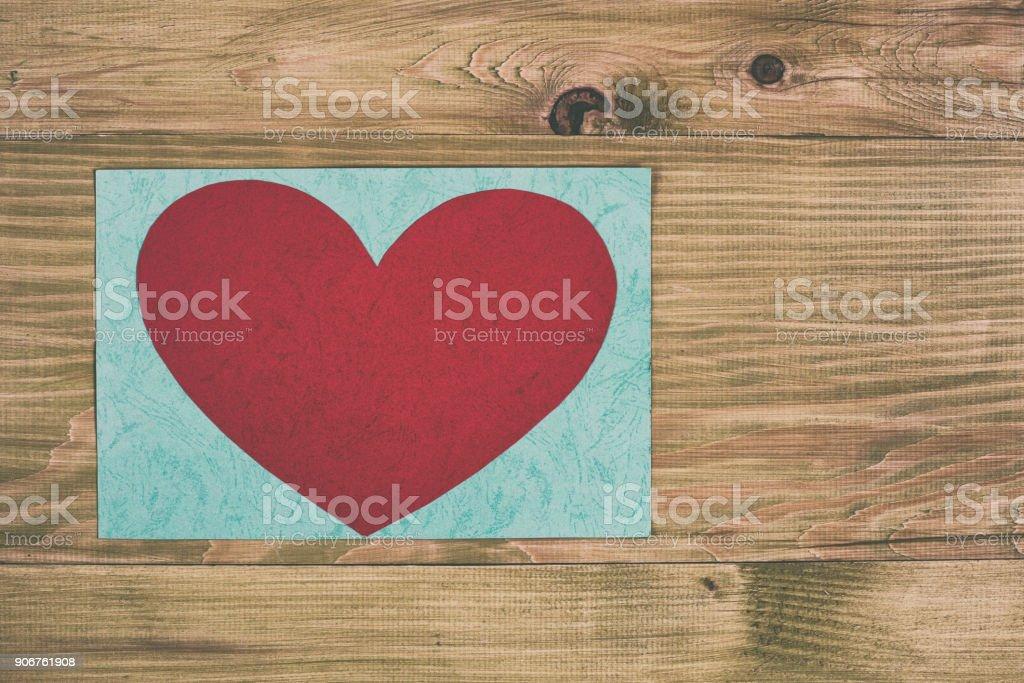 Heart on wooden table stock photo