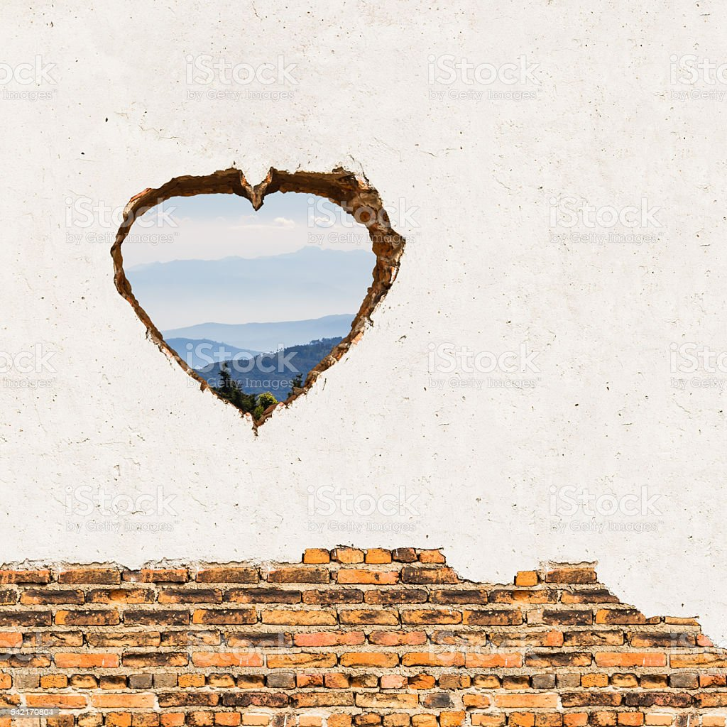 Heart opening on the wall stock photo