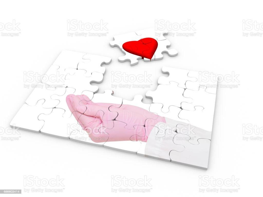 Coeur sur la main dans le gant médical photo libre de droits