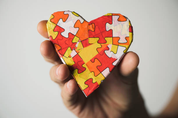 heart patterned with puzzle pieces, for the autism stock photo