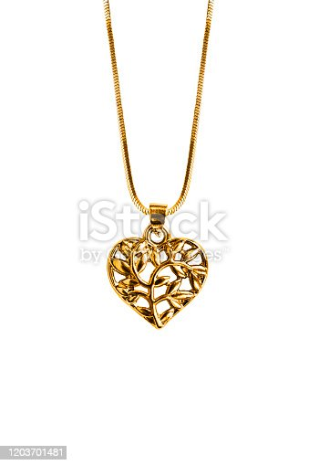 Gold heart shaped pendant hanging on a chain on white background