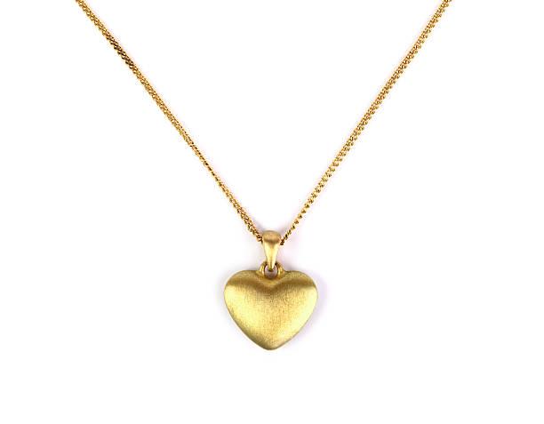 с кулоном в виде сердца - ожерелье стоковые фото и изображения
