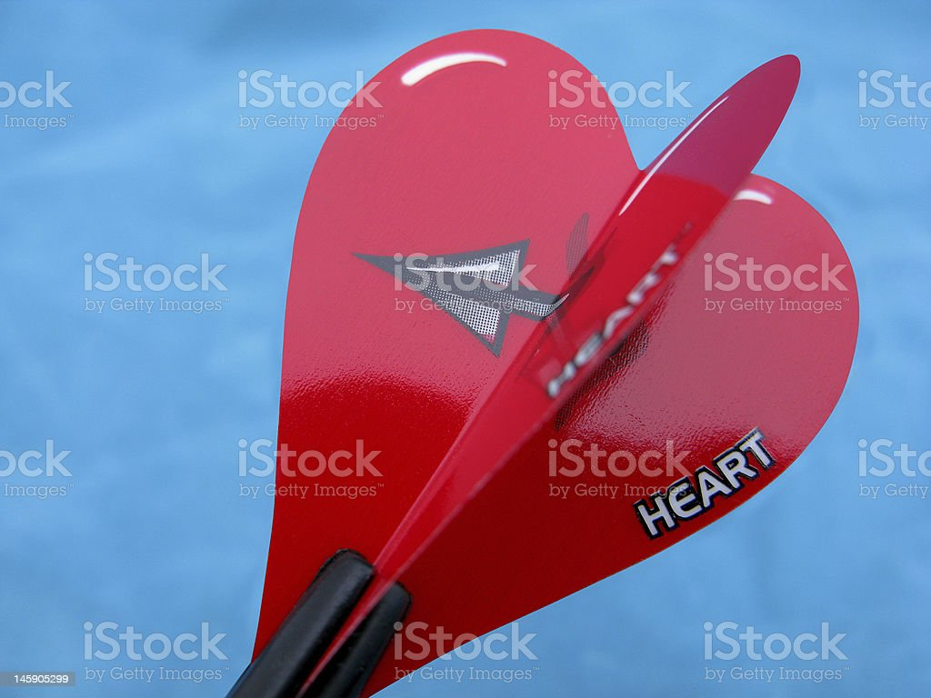 Heart pierced with a dart royalty-free stock photo