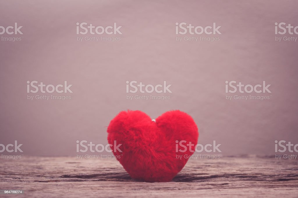 heart pillow and stethoscope on wooden table royalty-free stock photo