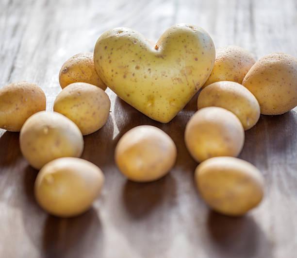 heart potato - prepared potato stock photos and pictures