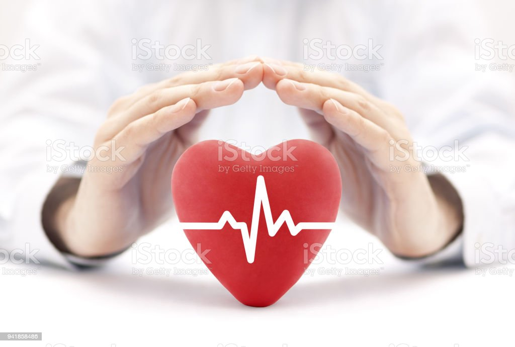 Heart pulse covered by hands. Health insurance concept stock photo