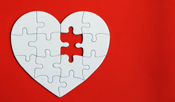 heart puzzle on the red background. a missing piece of the heart puzzle. - blood donation stock pictures, royalty-free photos & images