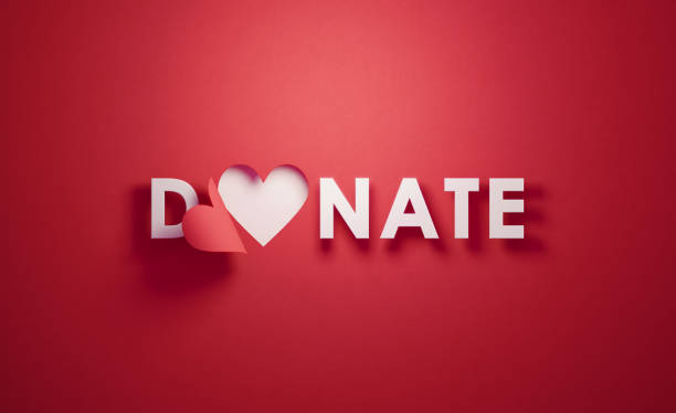 heart shape and donate text on red background - charity and relief work stock pictures, royalty-free photos & images