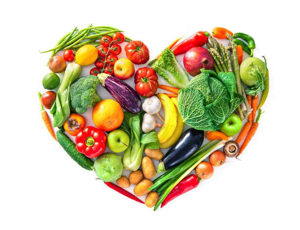 heart shape by various vegetables and fruits. healthy food concept - icona supermercato foto e immagini stock