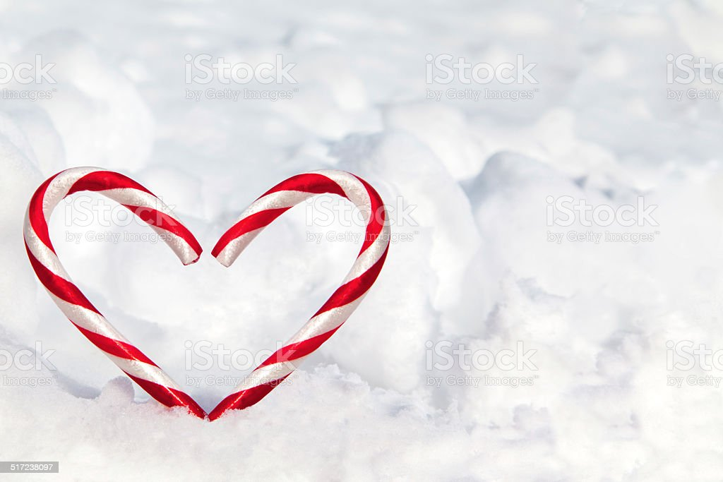 Heart Shape Candy Canes in the Snow stock photo