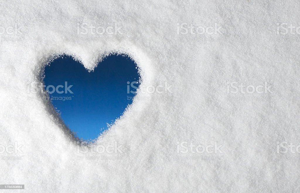 Heart Shape drawn on a Snow Frozen Window (XXXL) royalty-free stock photo
