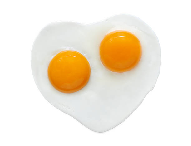 heart shape egg - fried egg stock photos and pictures