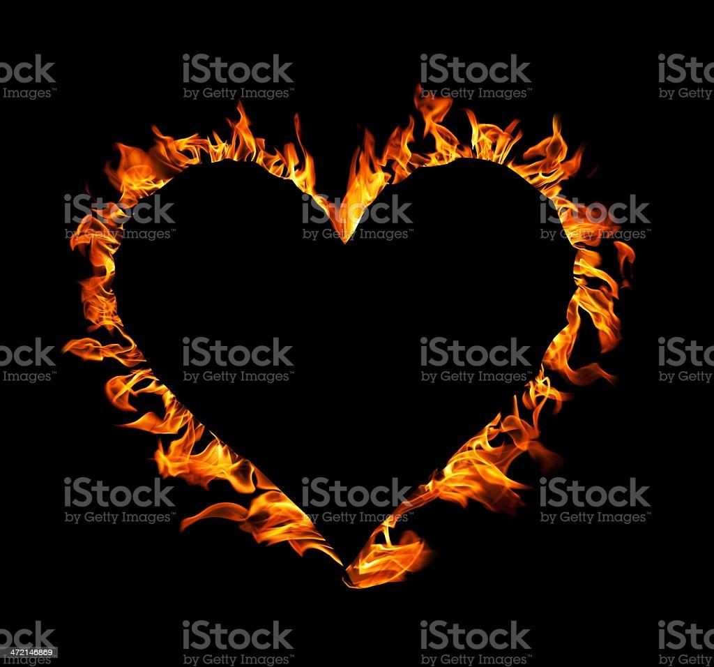 heart shape fire, flames on black background stock photo