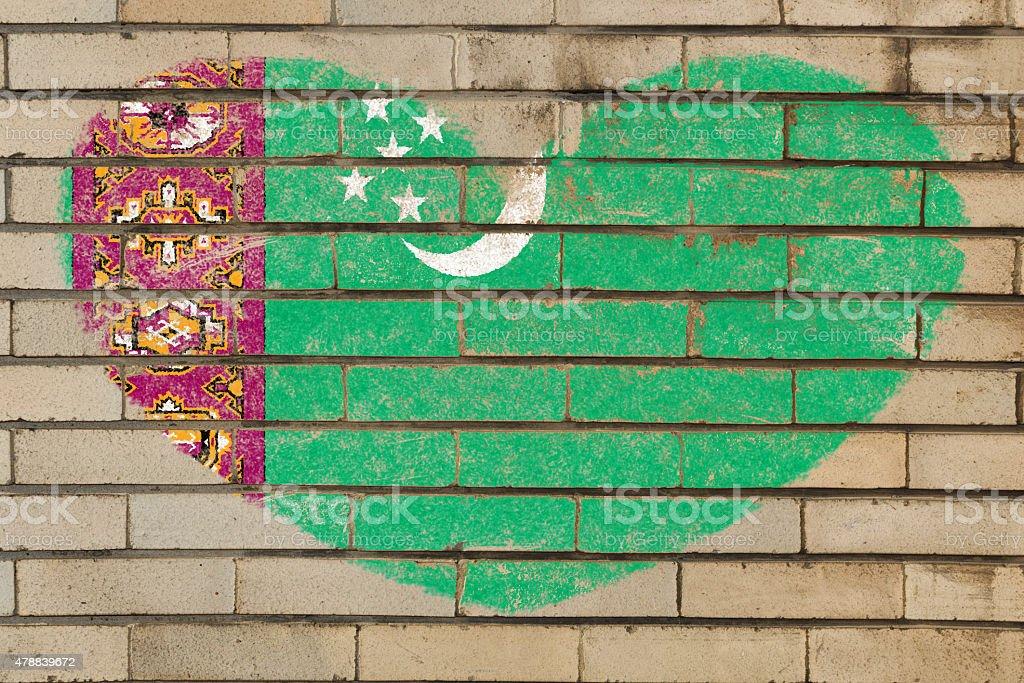 heart shape flag of turkmenistan on brick wall stock photo
