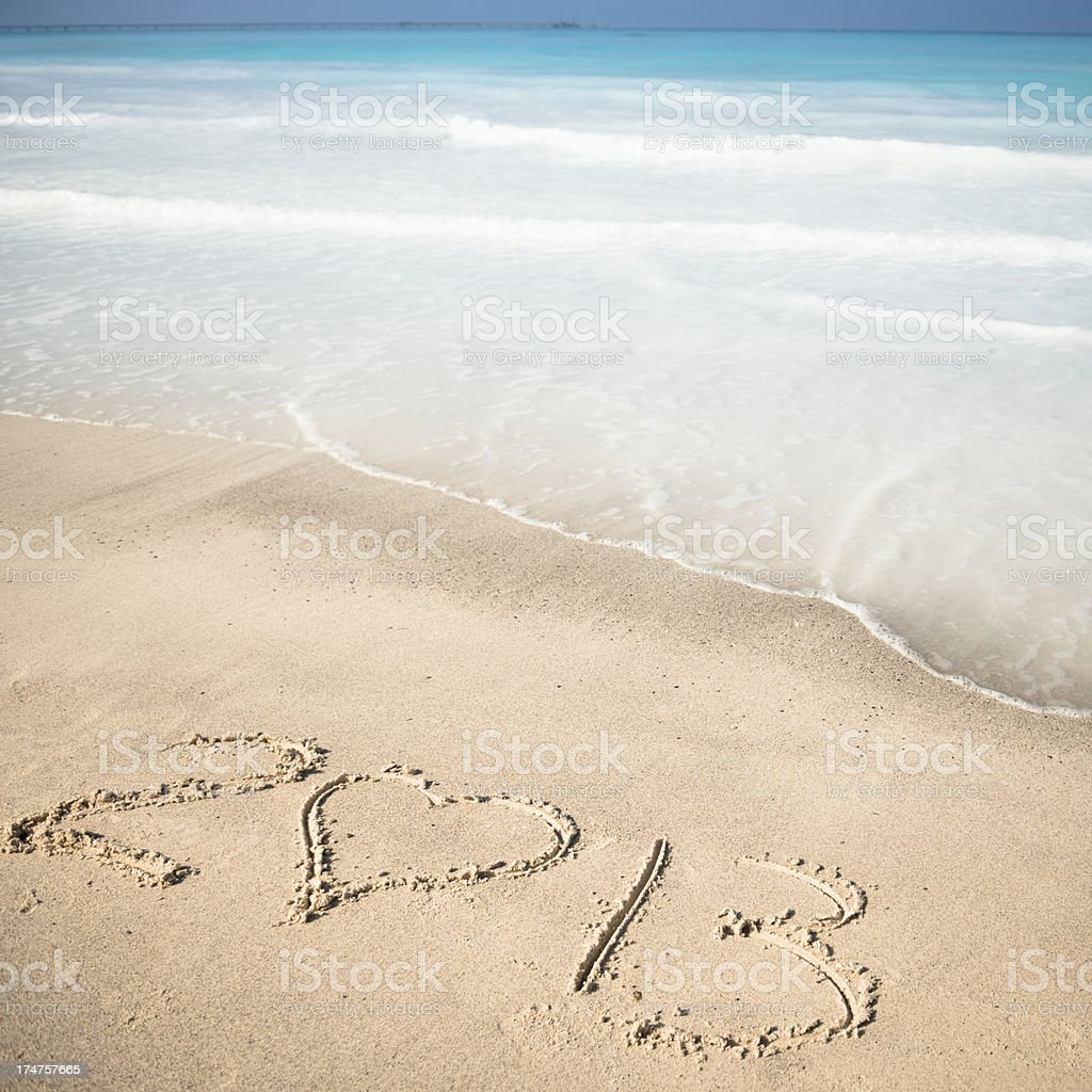 heart shape for 2013 text on sand beach royalty-free stock photo