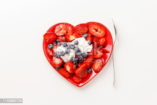 istock Heart shape fruit salad. 1140665729