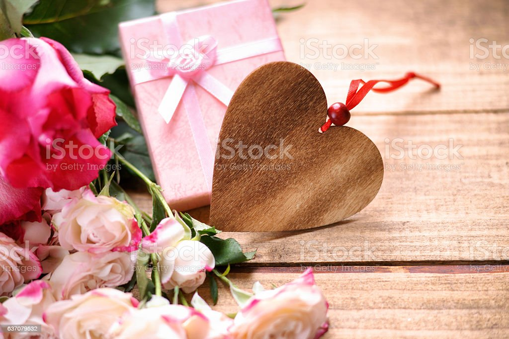 Heart shape, gift box and roses stock photo