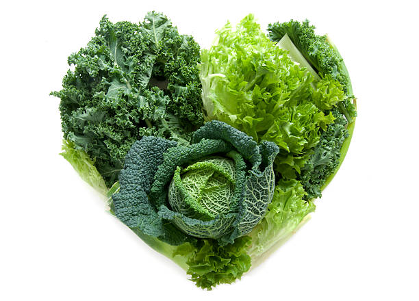 Heart shape green vegetables stock photo