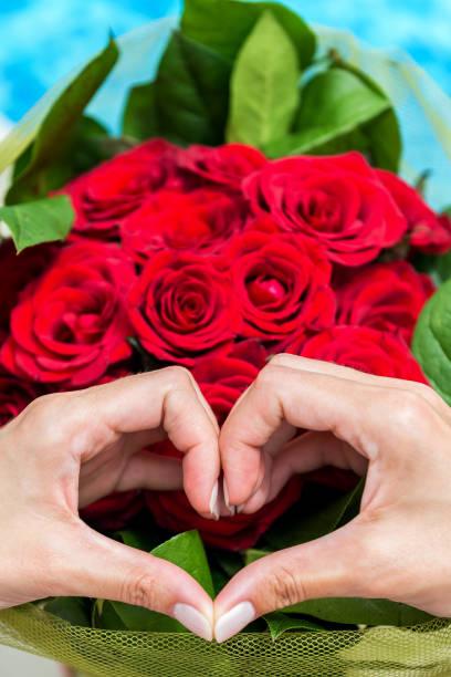Heart shape hands red roses picture id811875220?b=1&k=6&m=811875220&s=612x612&w=0&h=zeglrxg0oicdysfy9znbppy32f og5fkxilsfzxx2xa=
