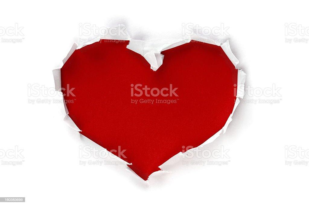 Heart shape hole through paper stock photo