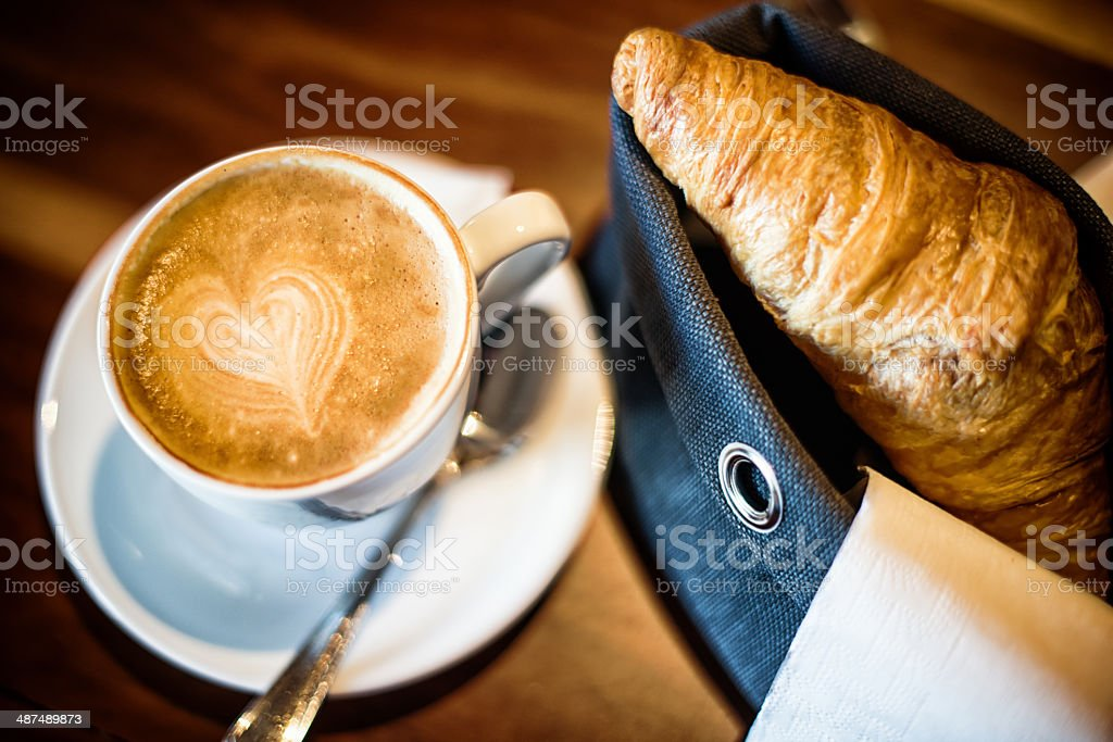 heart shape in coffee cup with croissant royalty-free stock photo