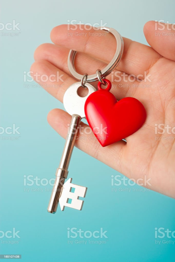 heart shape keyring with house shaped key stock photo more