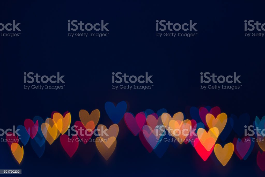 Heart shape lights line on dark background stock photo