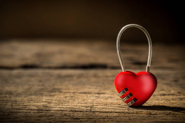 heart shape lock on grunge wooden stock photo