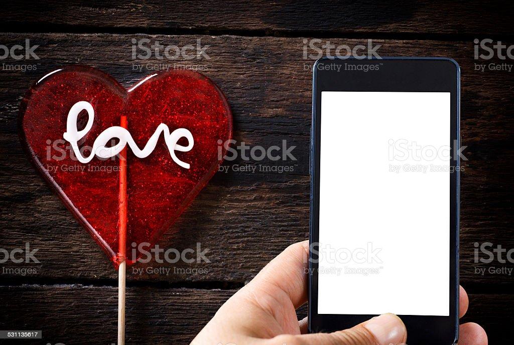 Heart shape lolly pop stock photo