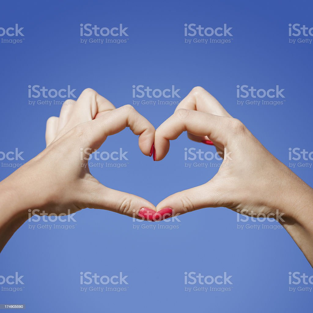 Heart shape made by female hands royalty-free stock photo