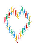 Multi colored paper clips, arranged like human heart symbol