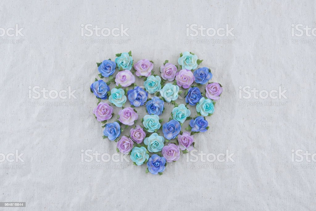 Heart shape made from blue tone rose paper flowers royalty-free stock photo