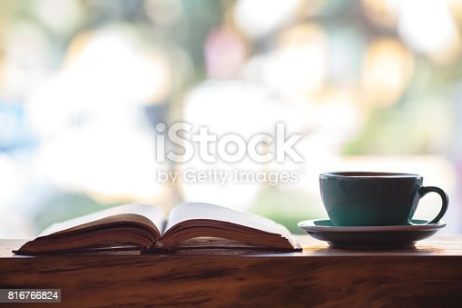 istock Heart shape made from book pages and coffee 816766824