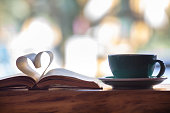 Heart shape made from book pages and coffee