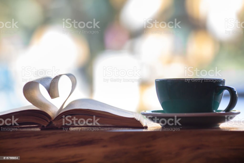 Heart shape made from book pages and coffee stock photo