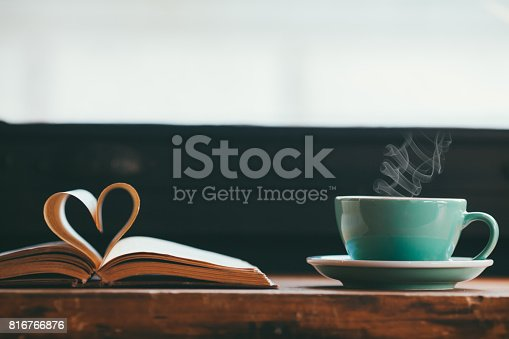 istock Heart shape made from book pages and coffee 816766876
