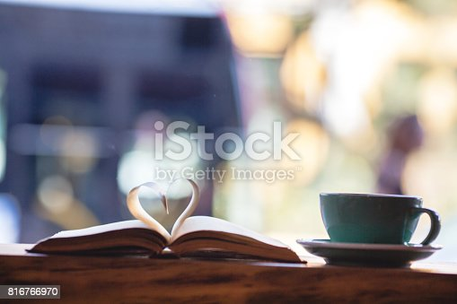 istock Heart shape made from book pages and coffee 816766970
