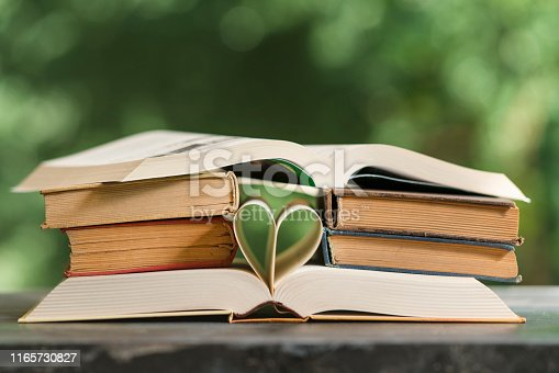 503708758istockphoto Heart shape made from book pages 1165730827