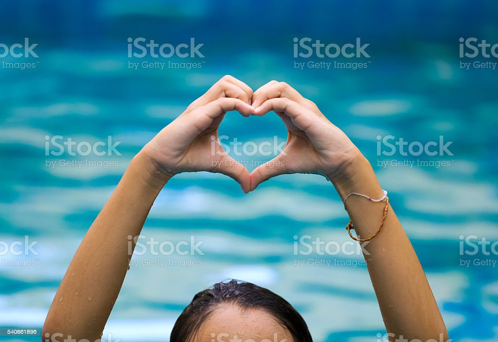 heart shape made of beautiful hand come up from water stock photo