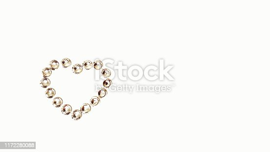 Heart shape made out of AB crystals isolated on white background, copy space.