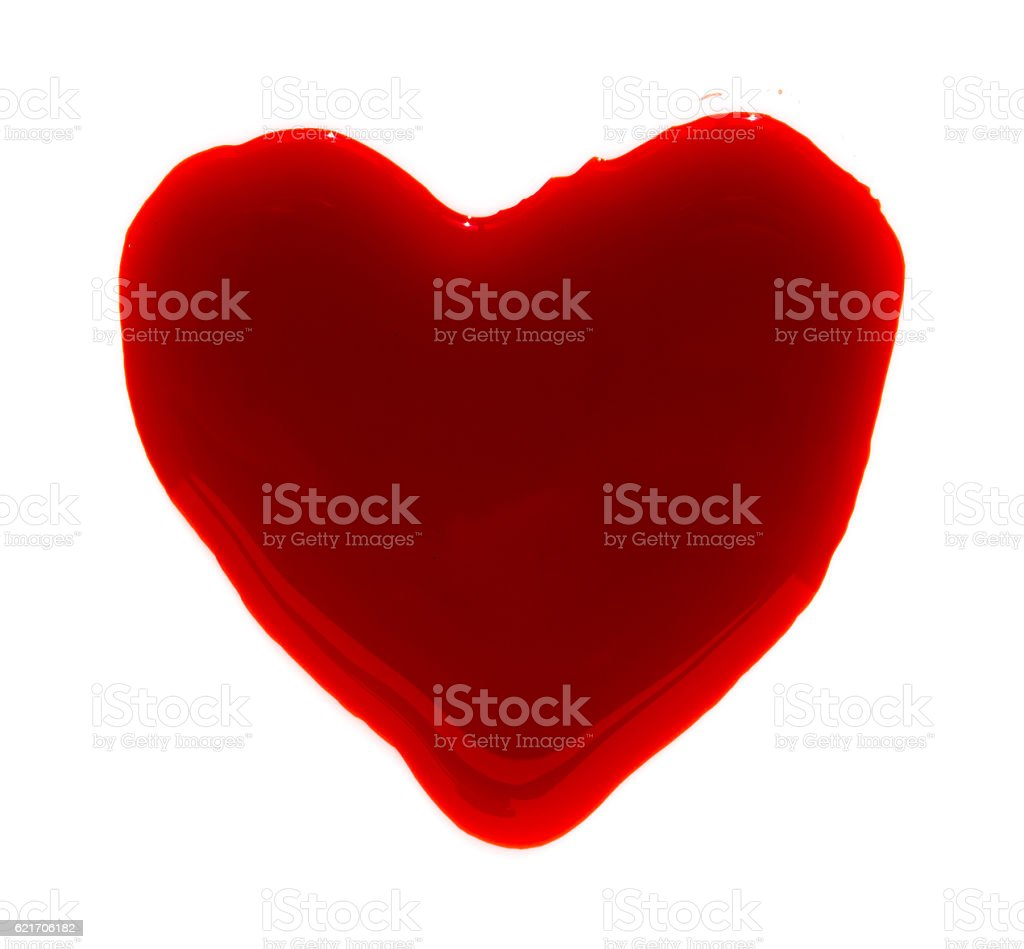 Heart shape of blood droplets on white background stock photo