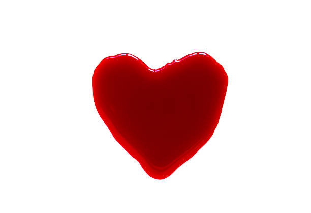 Heart shape of blood droplets on white background – Foto
