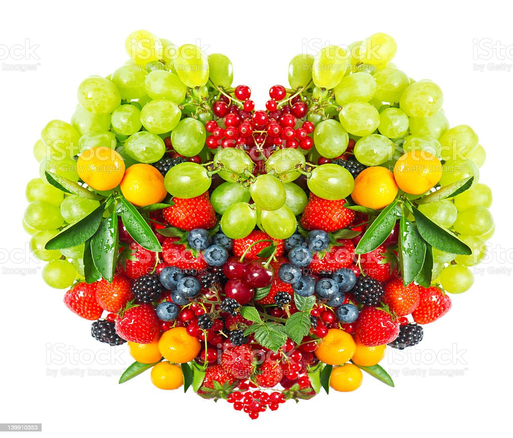 heart shape of mixed berries and fruits royalty-free stock photo
