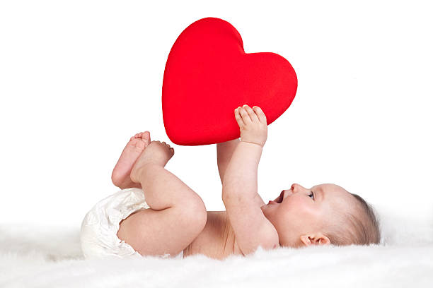 heart shape of the baby's hand stock photo