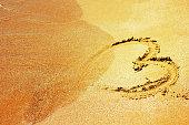 istock Heart shape on a beach 527707545