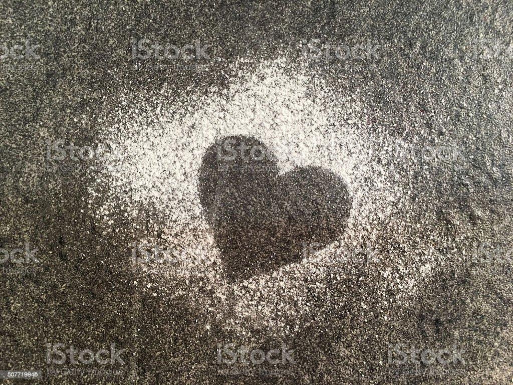 Heart shape on black slate background stock photo