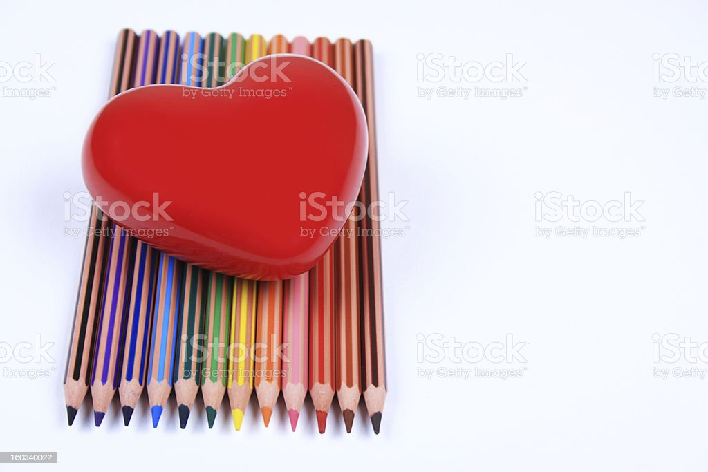 Heart shape on colored pencils royalty-free stock photo