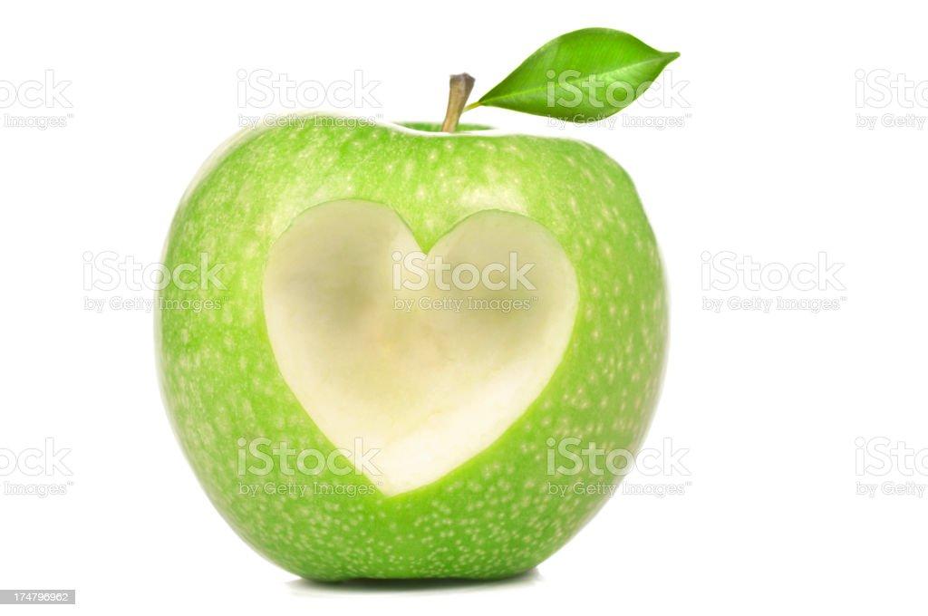 Heart shape on green apple stock photo