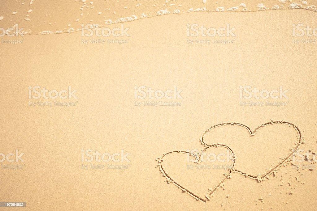 Heart shape on the beach stock photo
